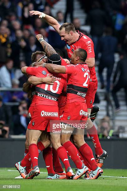 Drew Mitchell of Toulon is congratulated by teammates after scoring his team's second try during the European Rugby Champions Cup Final match between...