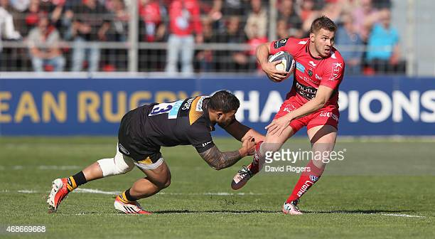 Drew Mitchell of Toulon is tackled by Alapati Leiua during the European Rugby Champions Cup quarter final match between RC Toulon and Wasps at the...