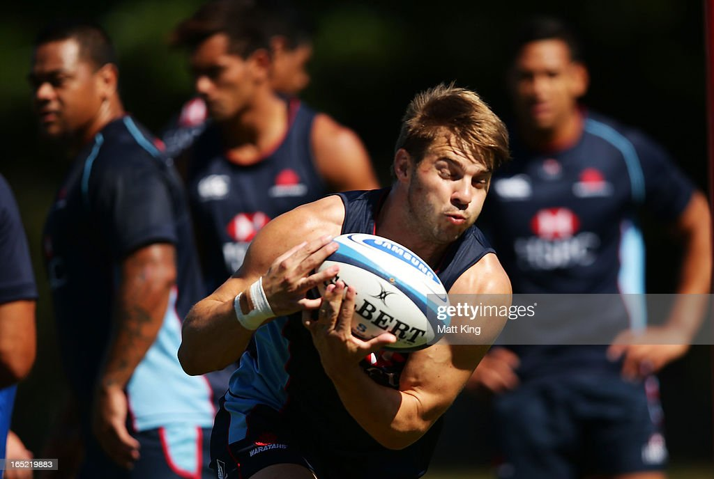 <a gi-track='captionPersonalityLinkClicked' href=/galleries/search?phrase=Drew+Mitchell&family=editorial&specificpeople=215065 ng-click='$event.stopPropagation()'>Drew Mitchell</a> takes a pass during a Waratahs Super Rugby training session at Moore Park on April 2, 2013 in Sydney, Australia.