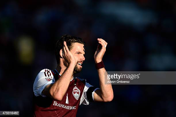 Drew Moor of Colorado Rapids claps to the crowd while playing the Portland Timbers during the first half of action The Colorado Rapids hosted the...