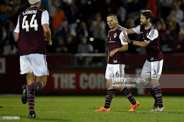 Drew Moor of Colorado Rapids pats Sam Cronin on the head after he tied the game 11 in the 89th minute against the Portland Timbers during the second...