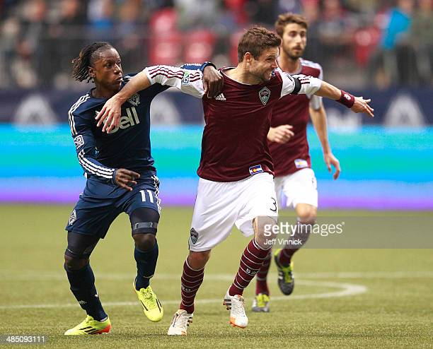 Drew Moor of the Colorado Rapids and Darren Mattocks of the Vancouver Whitecaps FC during their MLS game April 5 2014 in Vancouver British Columbia...