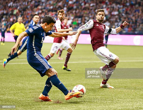 Drew Moor of the Colorado Rapids and Matas Laba of the Vancouver Whitecaps FC during their MLS game April 5 2014 in Vancouver British Columbia Canada