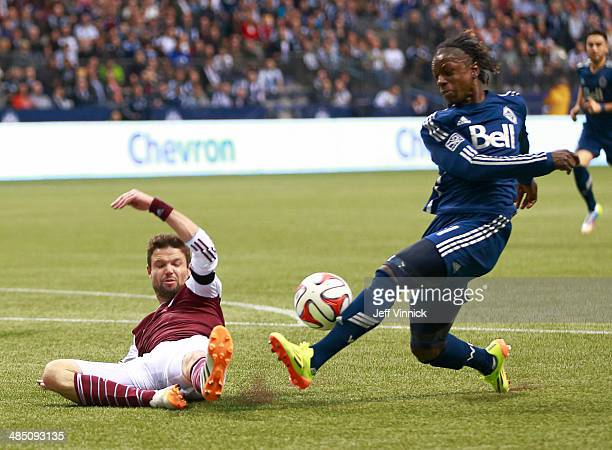 Drew Moor of the Colorado Rapids defends against Darren Mattocks of the Vancouver Whitecaps FC during their MLS game April 5 2014 in Vancouver...