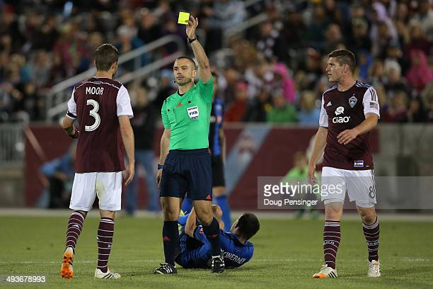 Drew Moor of the Colorado Rapids draws a yellow card from referee Chris Penso for a foul on Jack McInerney of the Montreal Impact at Dick's Sporting...