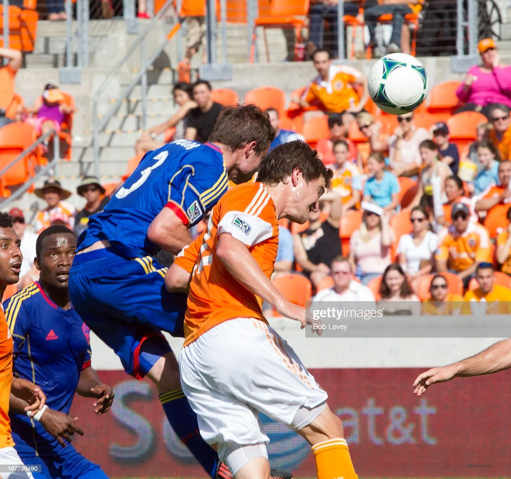 Drew Moor #3 of the Colorado Rapids heads the ball over Bobby Boswell #32 of the Houston Dynamo for a goal in the first half at BBVA Compass Stadium on April 28, 2013 in Houston, Texas.