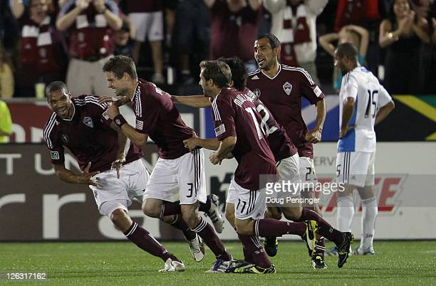 Drew Moor of the Colorado Rapids is surrounded by teammates Caleb Folan Brian Mullan Kosuke Kimura and Pablo Mastroeni of the Colorado Rapids as they...