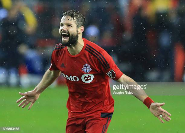 Drew Moor of Toronto FC celebrates at the final whistle following the MLS Eastern Conference Final Leg 2 game against Montreal Impact at BMO Field on...
