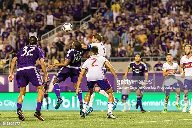 Drew Moor of Toronto FC pulls down Orlando City's Julio Baptista in the 97th minute to give up a penalty kick at Citrus Bowl on June 25 2016 in...