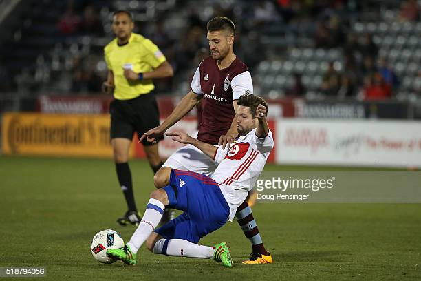 Drew Moor of Toronto FC steals the ball from Luis Solignac of Colorado Rapids at Dick's Sporting Goods Park on April 2 2016 in Commerce City Colorado...