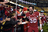 Drew Morgan of the Arkansas Razorbacks celebrates with fans following a victory over the LSU Tigers at Tiger Stadium on November 14 2015 in Baton...