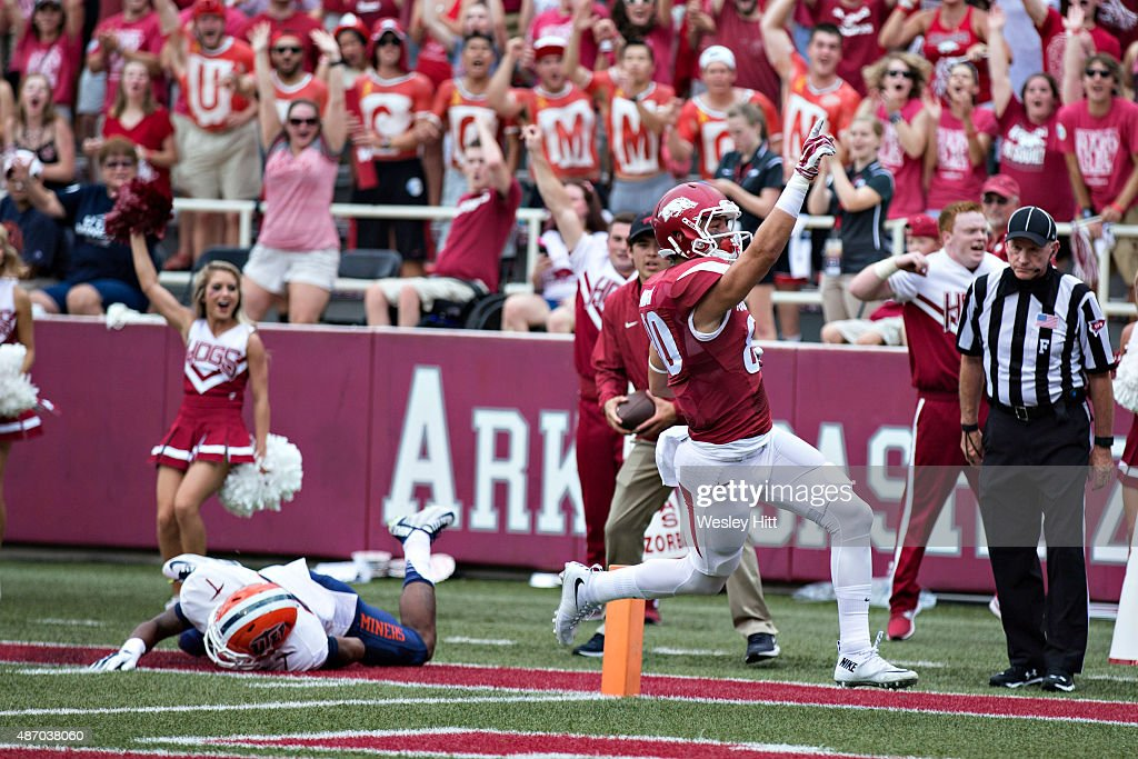 Drew Morgan of the Arkansas Razorbacks signals to the crowd after catching a pass for a touchdown during a game against the UTEP Miners at Donald W...