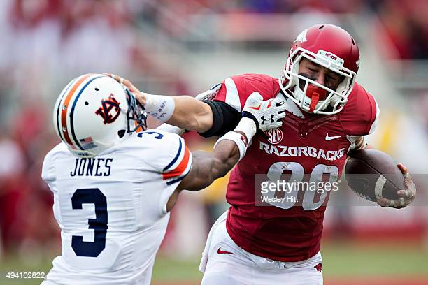 Drew Morgan of the Arkansas Razorbacks stiff arms Jonathan Jones of the Auburn Tigers at Razorback Stadium Stadium on October 24 2015 in Fayetteville...