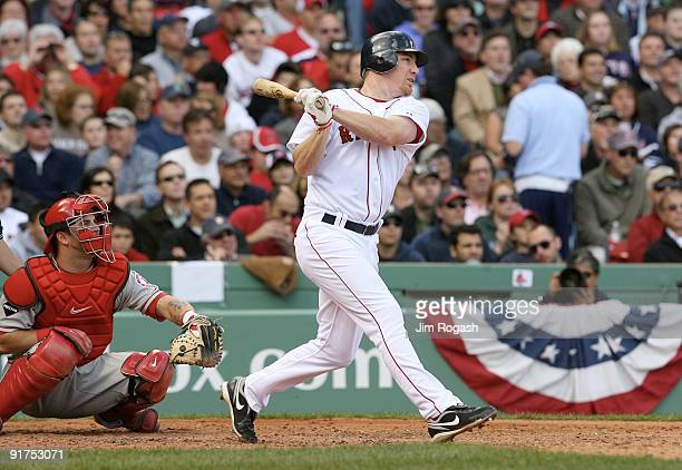 D Drew of the Boston Red Sox hits a tworun home run in the fourth inning against the Los Angeles Angels of Anaheim in Game Three of the ALDS during...