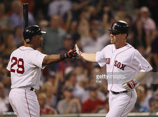 D Drew of the Boston Red Sox is congratulated by teammate Adrian Beltre after Drew scored on a single from David Oritz in the sixth inning against...