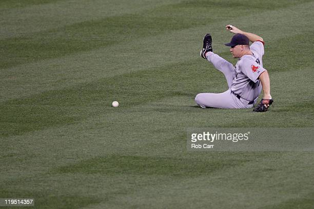 D Drew of the Boston Red Sox misses a ball hit by the Baltimore Orioles at Oriole Park at Camden Yards on July 18 2011 in Baltimore Maryland