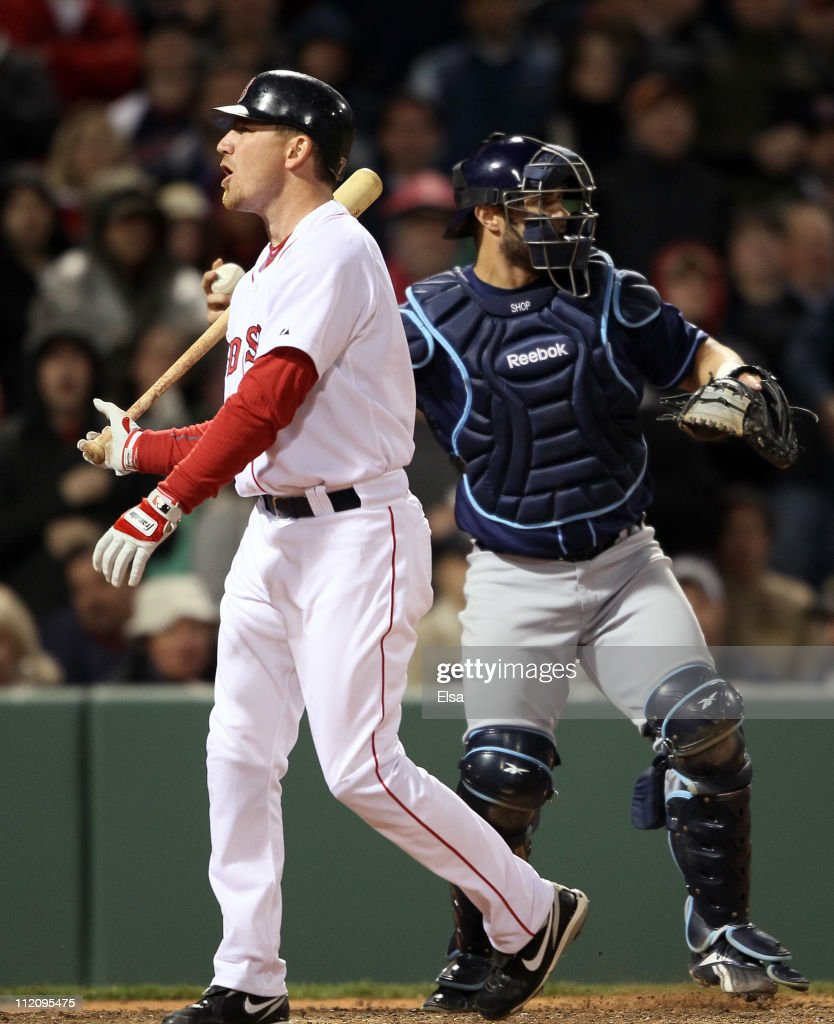 J.D. Drew #7 of the Boston Red Sox reacts after he struck out in the bottom of the ninth inning as Kelly Shoppach #10 of the Tampa Bay Rays catches on April 12, 2011 at Fenway Park in Boston, Massachusetts. The Tampa Bay Rays defeated the Boston Red Sox 3-2.