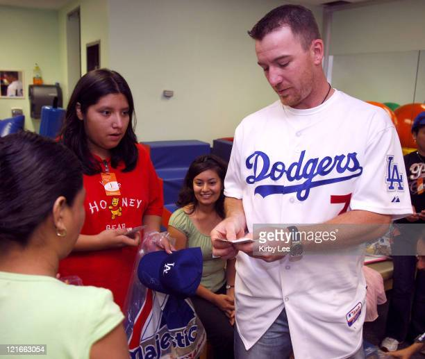 JD Drew of the Los Angeles Dodgers signs autographs during a visit to the White Memorial Medical Center Pediatric Unit in Los Angeles Calif on...