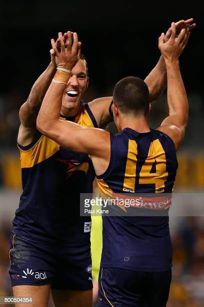 Drew Petrie and Liam Duggan of the Eagles celebrate a goal during the round 14 AFL match between the West Coast Eagles and the Melbourne Demons at...