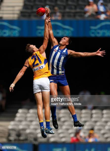 Drew Petrie of the Eagles and Braydon Preuss of the Kangaroos compete in a ruck contest during the 2017 AFL round 01 match between the North...