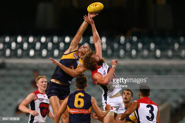 Drew Petrie of the Eagles and Jake Spencer of the Demons contest the ruck during the JLT Community Series AFL match between the West Coast Eagles and...