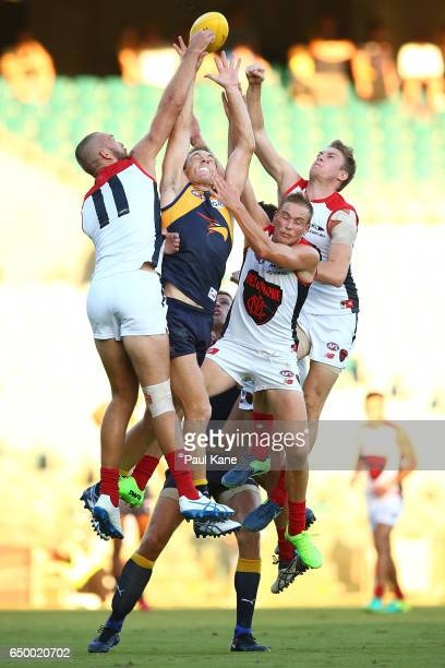 Drew Petrie of the Eagles contests a mark against Max Gawn Bernie Vince and Tom McDonald of the Demons during the JLT Community Series AFL match...