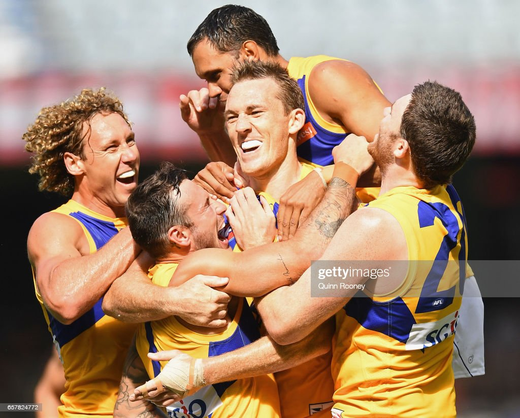 Drew Petrie of the Eagles is congratulated by team mates after kicking a goal during the round one AFL match between the North Melbourne Kangaroos and the West Coast Eagles at Etihad Stadium on March 26, 2017 in Melbourne, Australia.