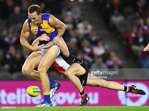 Drew Petrie of the Eagles is tackled by Jack Steele of the Saints during the round 20 AFL match between the St Kilda Saints and the West Coast Eagles...