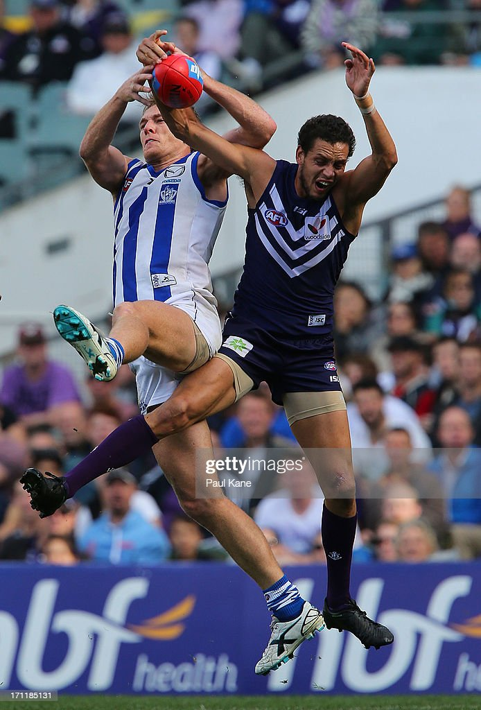 Drew Petrie of the Kangaroos and Michael Johnson of the Dockers contest for a mark during the round 13 AFL match between the Fremantle Dockers and the North Melbourne Kangaroos at Patersons Stadium on June 23, 2013 in Perth, Australia.