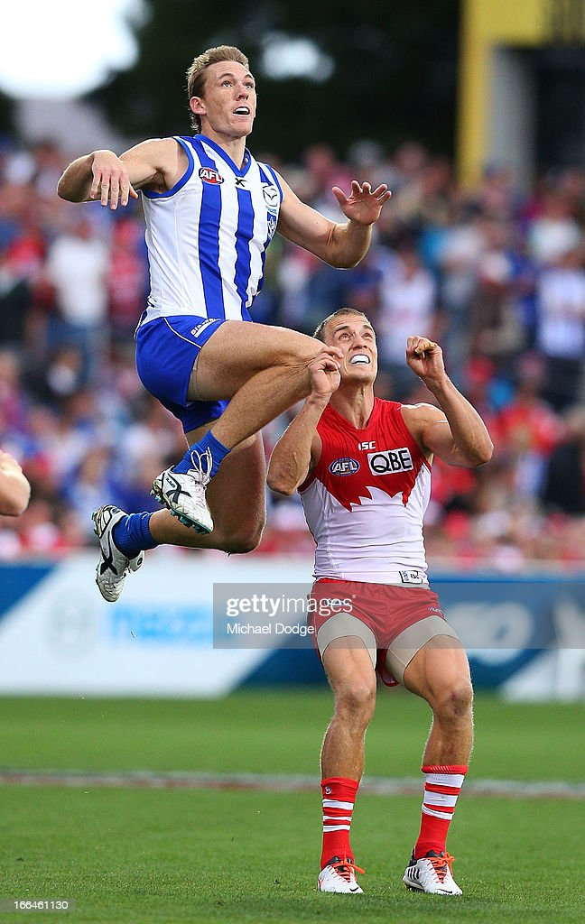 <a gi-track='captionPersonalityLinkClicked' href=/galleries/search?phrase=Drew+Petrie&family=editorial&specificpeople=216448 ng-click='$event.stopPropagation()'>Drew Petrie</a> of the Kangaroos jumps for a mark over Ted Richards of the Swans during the round three AFL match between the North Melbourne Kangaroos and the Sydney Swans at Blundstone Arena on April 13, 2013 in Hobart, Australia.