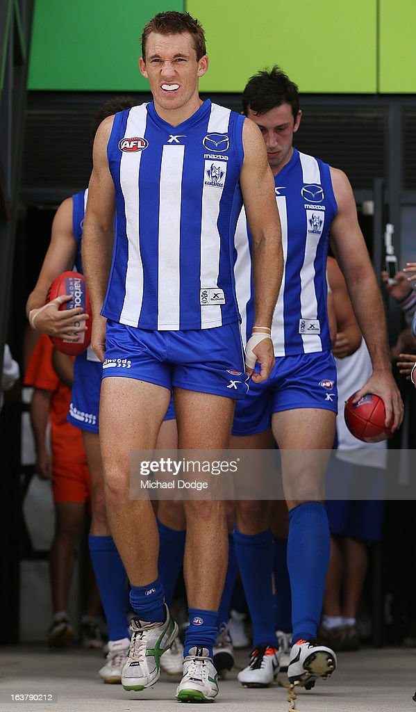 Drew Petrie of the Kangaroos leads the team onto the ground during the AFL NAB Cup match between the North Melbourne Kangaroos and the Hawthorn Hawks at Highgate Recreational Reserve on March 16, 2013 in Craigieburn, Australia.