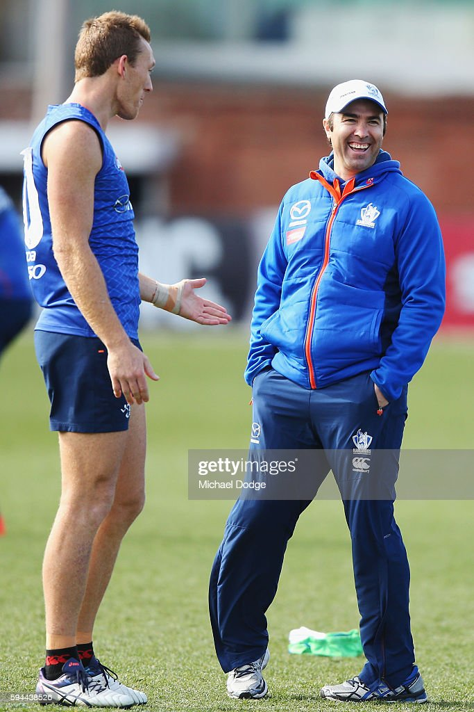 Drew Petrie of the Kangaroos not to be recontracted for next season by the club talks with Kangaroos head coach Brad Scott during a North Melbourne...