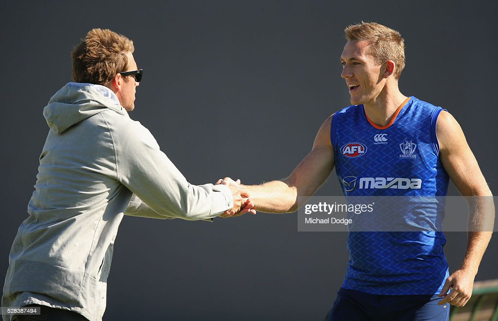 <a gi-track='captionPersonalityLinkClicked' href=/galleries/search?phrase=Drew+Petrie&family=editorial&specificpeople=216448 ng-click='$event.stopPropagation()'>Drew Petrie</a> of the Kangaroos, playing his 300th game this weekend, is wished well by former teammate <a gi-track='captionPersonalityLinkClicked' href=/galleries/search?phrase=Daniel+Pratt&family=editorial&specificpeople=542486 ng-click='$event.stopPropagation()'>Daniel Pratt</a> who turned up to watch a North Melbourne Kangaroos AFL media session at Arden Street Ground on May 5, 2016 in Melbourne, Australia.