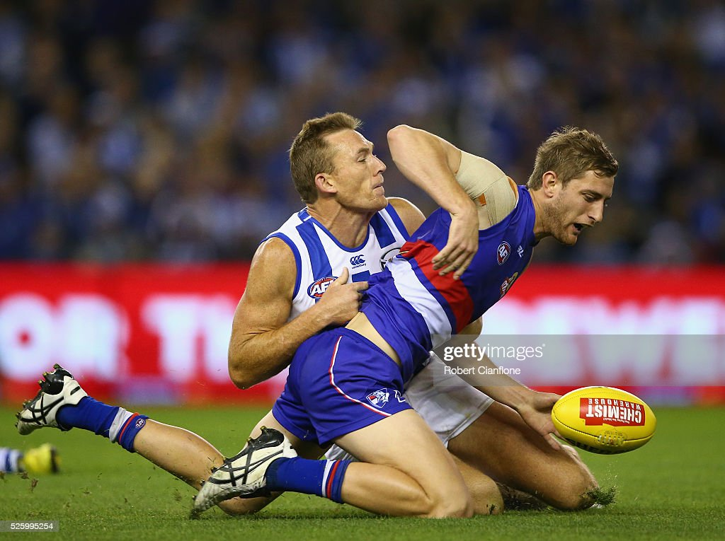 <a gi-track='captionPersonalityLinkClicked' href=/galleries/search?phrase=Drew+Petrie&family=editorial&specificpeople=216448 ng-click='$event.stopPropagation()'>Drew Petrie</a> of the Kangaroos tackles Fletcher Roberts of the Bulldogs during the round six AFL match between the North Melbourne Kangaroos and the Western Bulldogs at Etihad Stadium on April 29, 2016 in Melbourne, Australia.