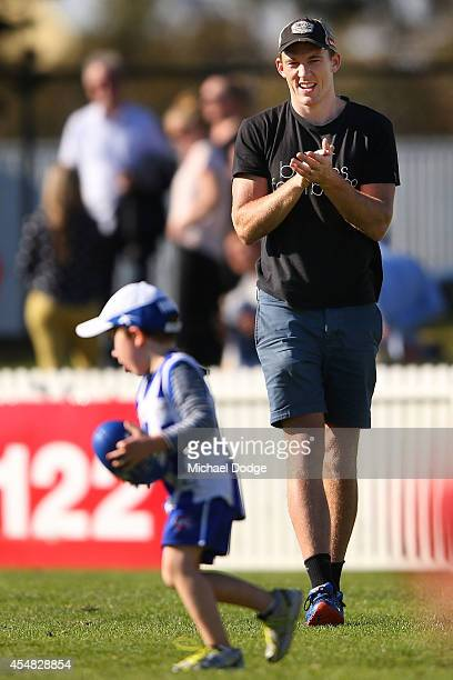 Drew Petrie of the Kangaroos who kicked the winning goal against the Bombers last night plays with his son Jack Petrie during the VFL Semi Final...