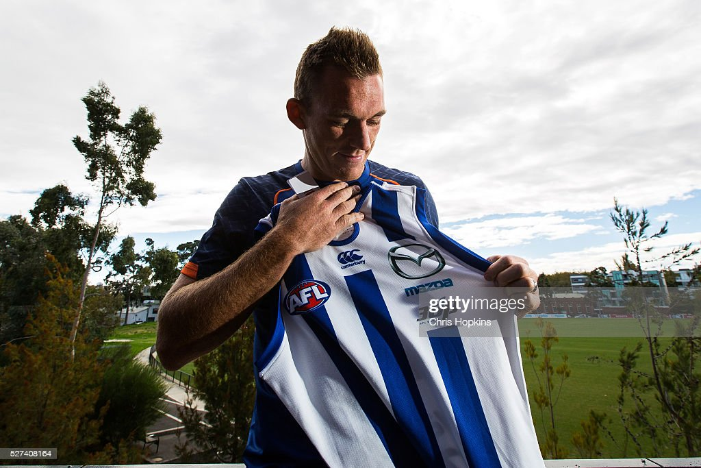 Drew Petrie with the jumper commemorating his 300 game after speaking to the media during a North Melbourne Kangaroos AFL media session at Arden Street Ground on May 3, 2016 in Melbourne, Australia.