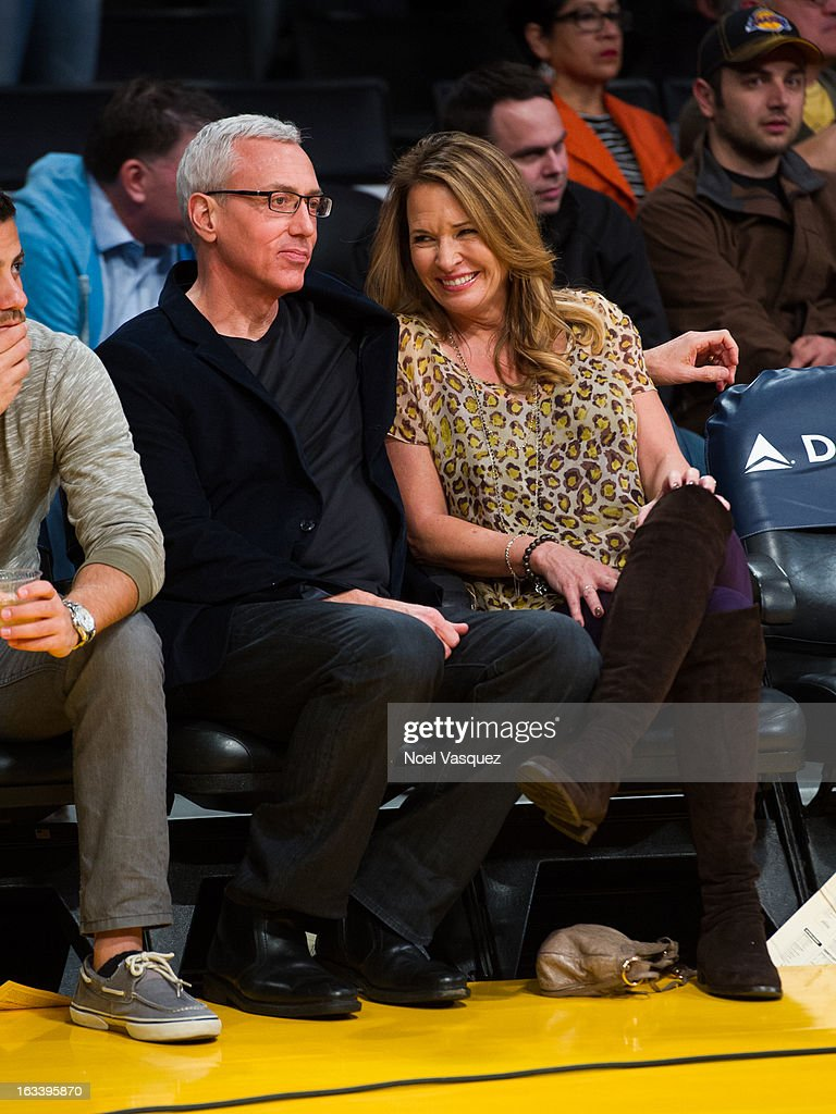 Drew Pinsky (L) and his wife Susan Pinsky attend a basketball game between the Toronto Raptors and Los Angeles Lakers at Staples Center on March 8, 2013 in Los Angeles, California.