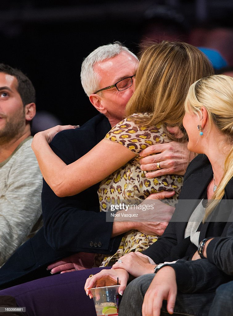 Drew Pinsky (L) and his wife Susan Pinsky kiss at a basketball game between the Toronto Raptors and Los Angeles Lakers at Staples Center on March 8, 2013 in Los Angeles, California.
