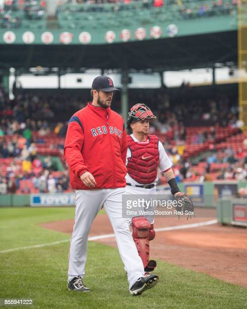 Drew Pomeranz and Christian Vazquez of the Boston Red Sox walk toward the dugout before a game against the Houston Astros on September 30 2017 at...