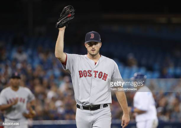Drew Pomeranz of the Boston Red Sox holds up the ball after snaring a line drive up the middle for the final out of the fifth inning as he leaves the...