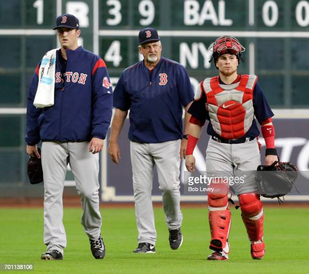 Drew Pomeranz of the Boston Red Sox makes his way in from the bullpen with Christian Vazquez and pitching coach Carl Willis at Minute Maid Park on...