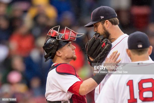 Drew Pomeranz of the Boston Red Sox reacts with Christian Vazquez as he exits the game during the seventh inning of a game against the Houston Astros...