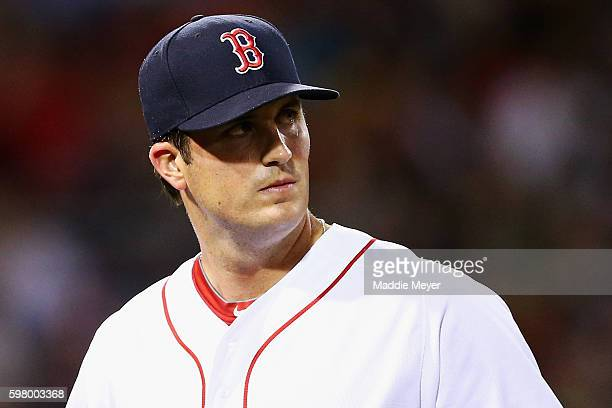 Drew Pomeranz of the Boston Red Sox returns to the dugout after being relieved during the seventh inning against the Tampa Bay Rays at Fenway Park on...