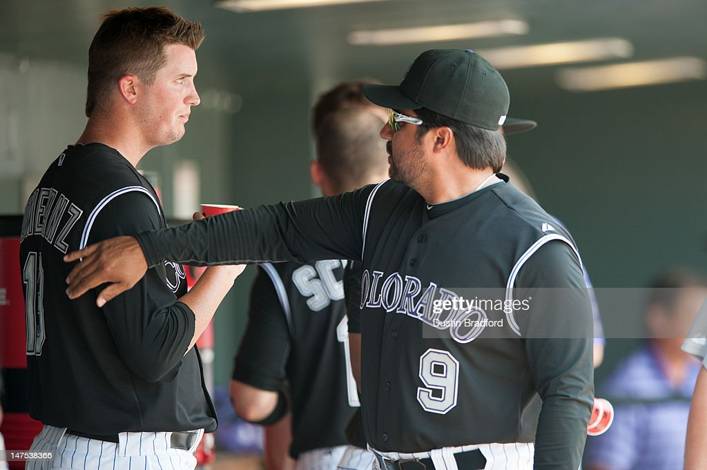 Drew Pomeranz of the Colorado Rockies is congratulated in the dugout by special assistant Vinny Castilla of the Colorado Rockies during a game...