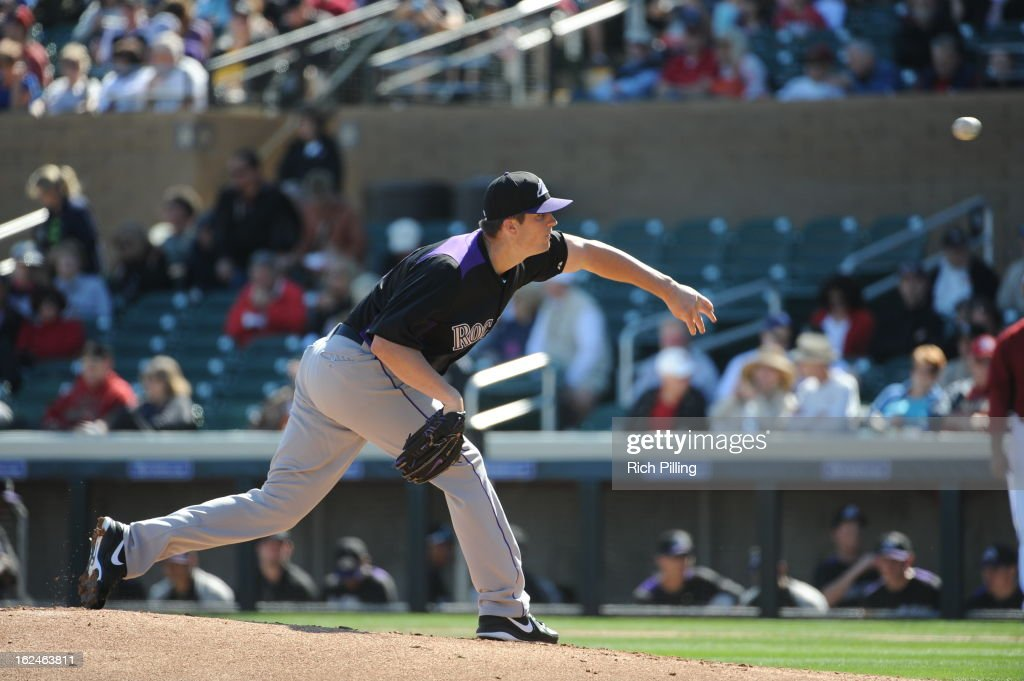 <a gi-track='captionPersonalityLinkClicked' href=/galleries/search?phrase=Drew+Pomeranz&family=editorial&specificpeople=7513241 ng-click='$event.stopPropagation()'>Drew Pomeranz</a> #13 of the Colorado Rockies pitches during the game against the Arizona Diamondbacks on February 23, 2013 at the Salt River Fields at Talking Stick in Scottsdale, Arizona. The Rockies defeated the Diamondbacks 11-2.