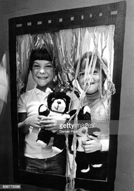 Drew Rowley and Corey Stewart peek out of the window of a cardboard Haunts house that they and classmates with the help of teachers constructed at...