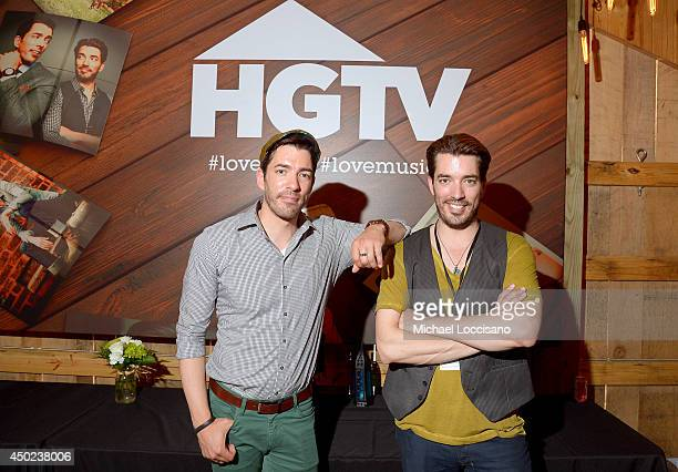 Drew Scott and Jonathan Scott of Property Brothers pose at HGTVs The Lodge at CMA Music Fest 2014 on June 7 2014 in Nashville Tennessee