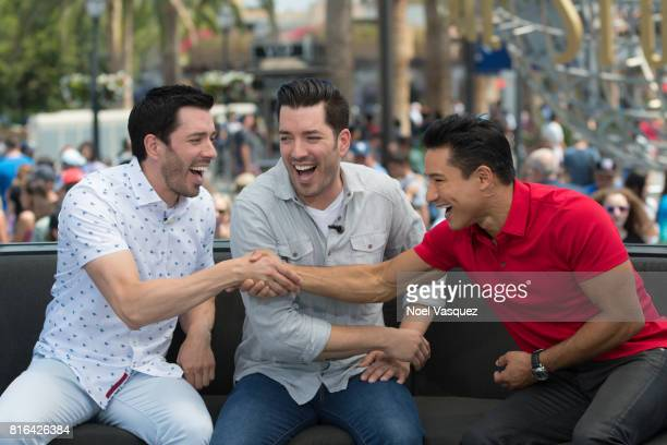 Drew Scott Jonathan Scott and Mario Lopez visit 'Extra' at Universal Studios Hollywood on July 17 2017 in Universal City California