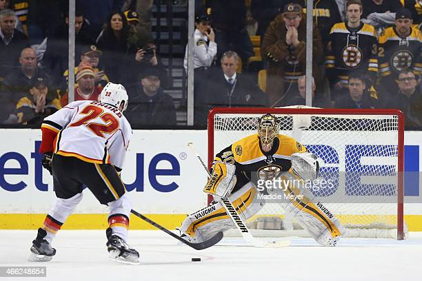 Drew Shore of the Calgary Flames takes a shot against Tuukka Rask of the Boston Bruins during a shootout at TD Garden on March 5 2015 in Boston...