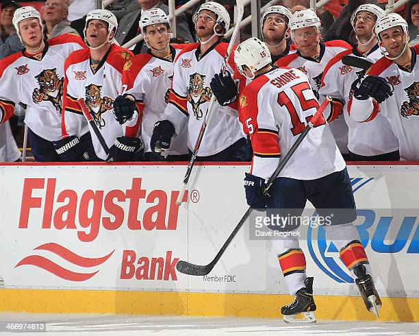 Drew Shore of the Florida Panthers celebrates a late third period goal to tie the game with teammates on the bench during an NHL game against the...